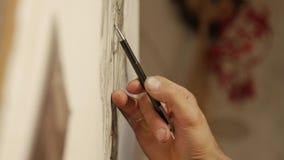 Teckningsprocessen: en närbild av det handblyertspennan och papperet lager videofilmer