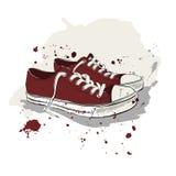 Teckningsvektorillustration med röda gymnastikskor royaltyfri illustrationer