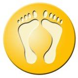 Tecla dourada com pés Fotos de Stock Royalty Free