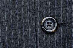 Tecla em um terno listrado do pino Fotos de Stock