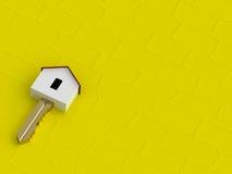 tecla HOME de oro 3D en fondo amarillo Fotografía de archivo