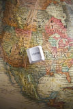 Tecla HOME em um globo da terra Imagem de Stock Royalty Free