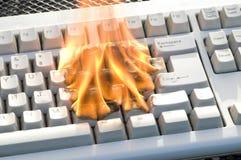 Teclado ardente imagens de stock