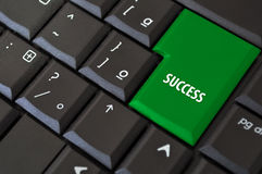 Teclado com uma chave ao sucesso Fotos de Stock