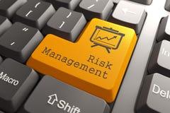 Teclado con el botón de la gestión de riesgos. Imagen de archivo libre de regalías