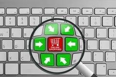 Teclado con los botones y la lupa en línea rojos y verdes del tema de las compras Imagen de archivo libre de regalías