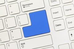 Teclado conceptual blanco - llave azul en blanco Imagen de archivo libre de regalías