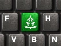 Teclado de computador com chave da árvore de Natal Imagem de Stock