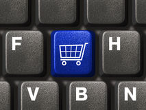 Teclado de computador com chave da compra Imagens de Stock