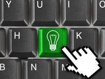 Teclado de computador com chave da lâmpada Imagem de Stock Royalty Free