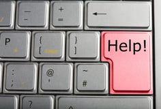 Teclado de computador com chave de ajuda vermelha Fotografia de Stock