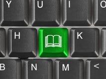 Teclado de computador com chave do livro Imagem de Stock Royalty Free