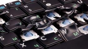 Teclado de la computadora portátil con claves torcidos Imagen de archivo libre de regalías