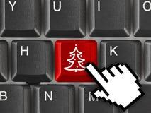 Teclado de ordenador con clave del árbol de navidad Fotos de archivo libres de regalías