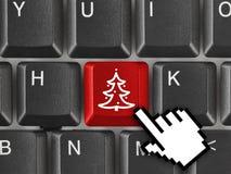 Teclado de ordenador con clave del árbol de navidad Foto de archivo