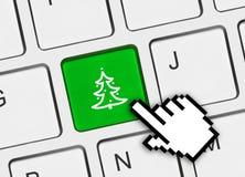 Teclado de ordenador con clave del árbol de navidad Foto de archivo libre de regalías