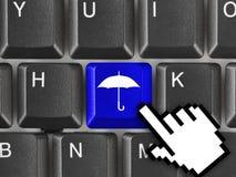 Teclado de ordenador con llave del paraguas Fotos de archivo