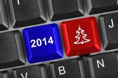 Teclado de ordenador con llaves de la Navidad Fotos de archivo