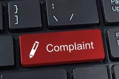 Teclado do botão da queixa com ícone da pena. imagens de stock royalty free