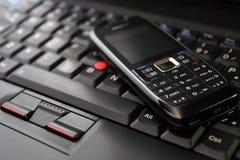 Teclado do telefone móvel e do portátil imagem de stock