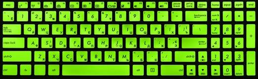 Teclado negro y verde moderno del ordenador portátil Foto de archivo