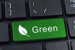 Teclado verde del botón con el icono de la hoja. Foto de archivo