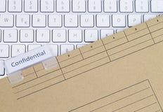 Teclado y carpeta confidenciales Foto de archivo libre de regalías