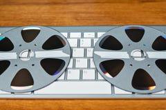 Teclado y CD en la forma de carrete Fotografía de archivo libre de regalías
