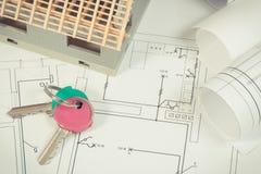 Teclas HOME, casa sob a construção e diagramas bondes para trabalhos do coordenador, conceito home de construção Fotos de Stock