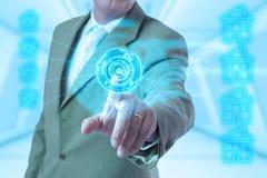 Tecnología de la mano del hombre de negocios Foto de archivo libre de regalías