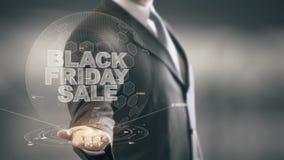 Tecnologías disponibles de Holding del hombre de negocios de la venta de Black Friday nuevas almacen de video