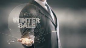 Tecnologías disponibles de Holding del hombre de negocios de la venta del invierno nuevas stock de ilustración