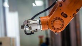 Tecnologia do mecanismo da mão do robô industrial foto de stock