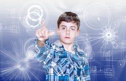 Tecnology y niño Foto de archivo libre de regalías