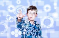 Tecnology y niño Foto de archivo