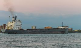 The TECUMSEH Bulk Carrier ship on the Detroit River at dusk. Detroit, MI, USA - 2 October 2016: The TECUMSEH Bulk Carrier ship on the Detroit River at dusk as stock image