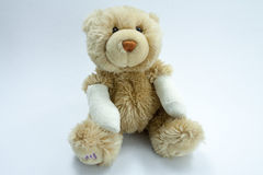 Ted injured. An injured teddy. His arms are burned or broken Stock Images