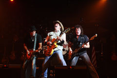 Ted Nugent. PHOENIX, AZ - JUNE 28: The Ted Nugent band, Derek St. Holmes (left) Ted Nugent (center) and Greg Smith (right) performs for fans at the Celebrity Royalty Free Stock Photo