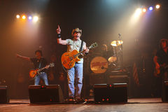 Ted Nugent. PHOENIX, AZ - JUNE 28: The Ted Nugent band, Derek St. Holmes (left) Ted Nugent (center) and Greg Smith (right) performs for fans at the Celebrity royalty free stock images