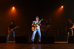 Ted Nugent. PHOENIX, AZ - JUNE 28: The Ted Nugent band, Derek St. Holmes (left) Ted Nugent (center) and Greg Smith (right) performs for fans at the Celebrity royalty free stock image
