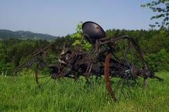 Tedder. Vintage hay tedder on green grass Stock Photos
