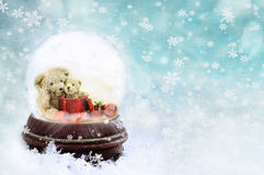 Teddies in a Snow Globe Stock Images