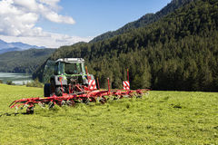 Tedding hay with tractor Royalty Free Stock Image