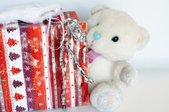 Teddy. Gift-wrap with a big white teddy bears inside Stock Photography