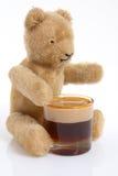 Teddy ale. Teddy bear enjoying a pint of ale Stock Photos