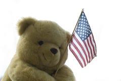 Teddy America. Isolated Teddy Bear holding the american flag Stock Photos