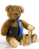 Teddy as a businessman with money or coins (EURO). Teddy as a businessman, who proudly presents its stacked money. He has a black briefcase under his arm and Royalty Free Stock Photos
