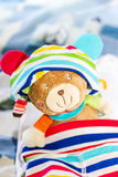 Teddy in baby outfit Stock Photography