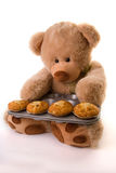 Teddy baking muffins Stock Images