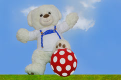 Teddy with ball Royalty Free Stock Photography